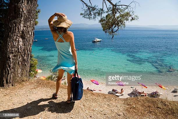 Woman looking at the sea, Bol, Brac Island, Dalmatia, Croatia, Adriatic Sea, Mediterranean, Europe