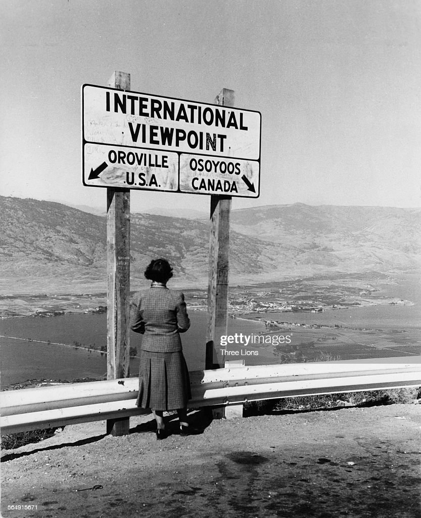 A woman looking at the view over the southern part of the Okanagan Valley, British Columbia, Canada, circa 1958. She is at an international viewpoint on the Canadian-US border between Osoyoos, British Columbia, and Oroville, Washington, USA.