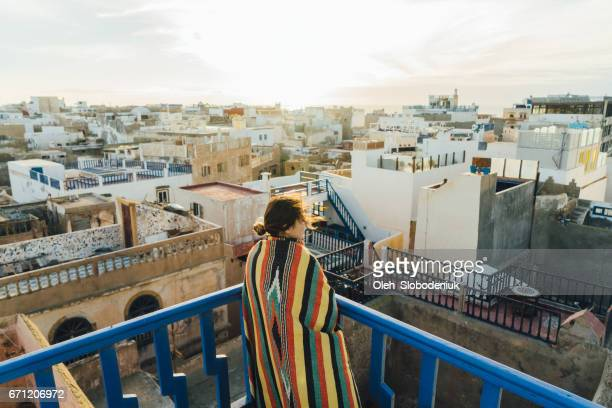 Woman looking at view from roof in Essaouria
