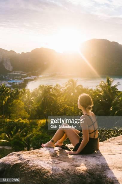 Woman looking at view of Koh Phi Phi at sunset