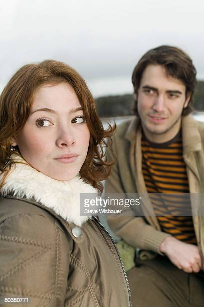 Woman looking away from man