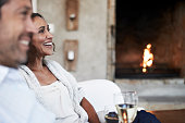 Woman looking away while sitting by man in resort
