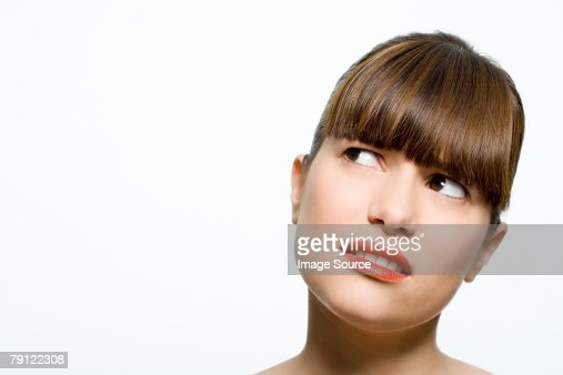 Woman looking confused : Stock Photo