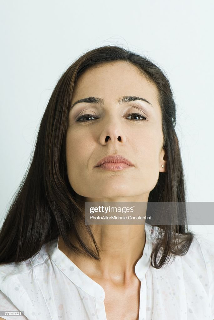 Woman looking down nose at camera, portrait