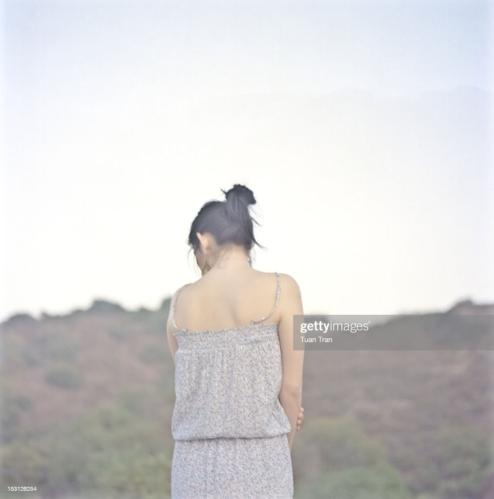 Woman looking down : Stock Photo
