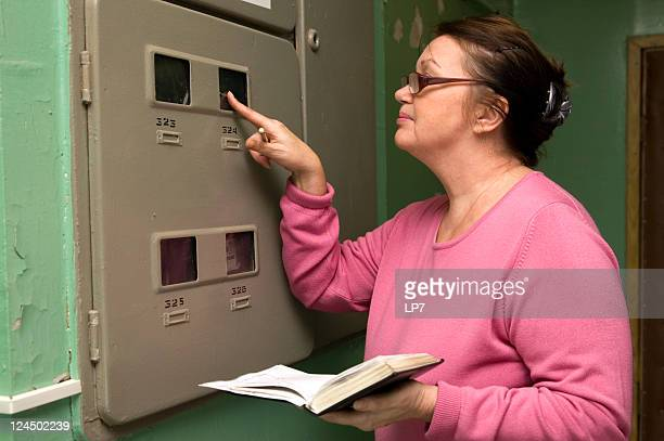 Woman looking electric meter data