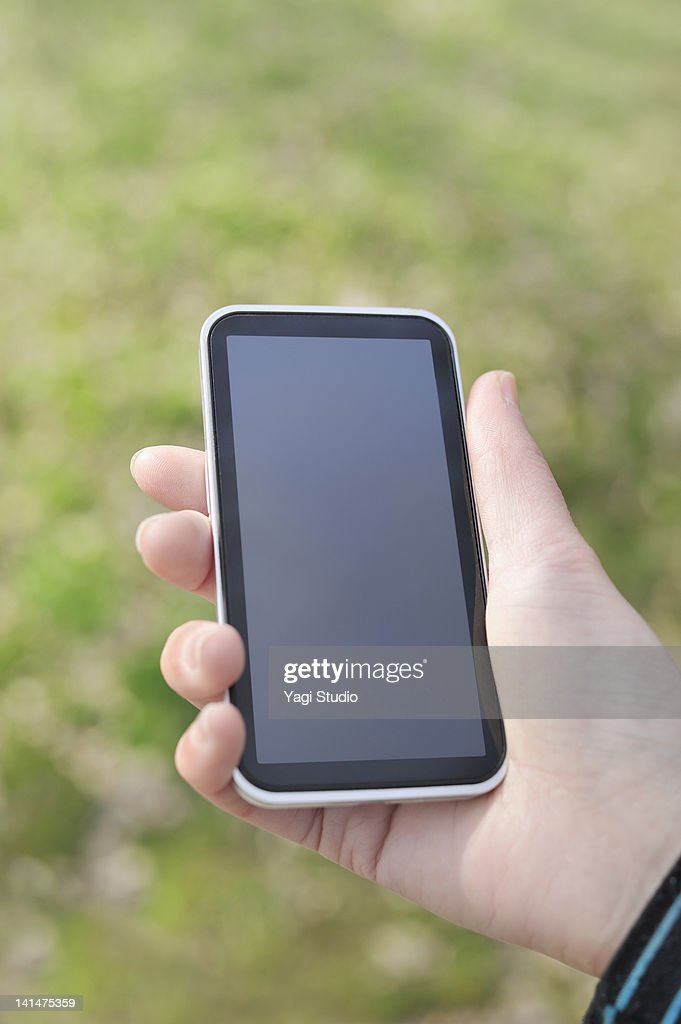 Woman looking for directions on an smart phone : Stock Photo