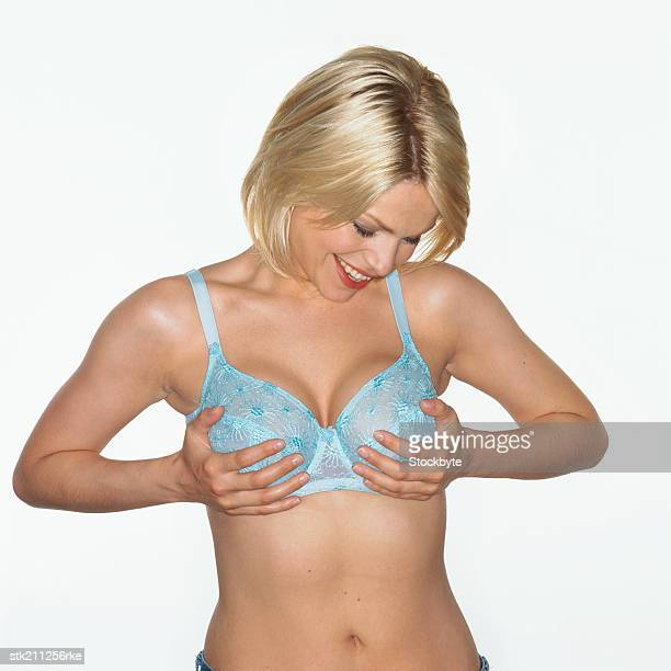 woman looking happily at her breasts