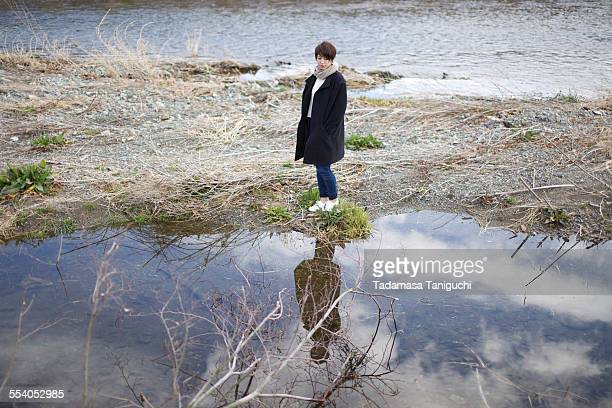 Woman looking herself with water reflection