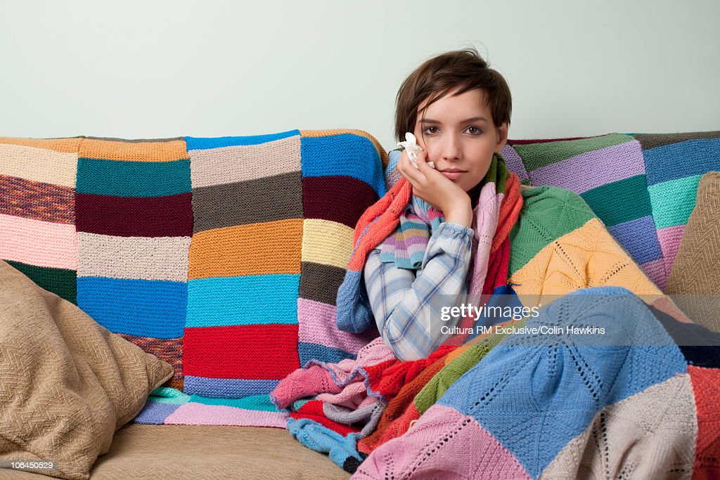 Woman looking ill on sofa