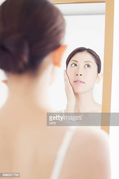 A woman looking in a mirror