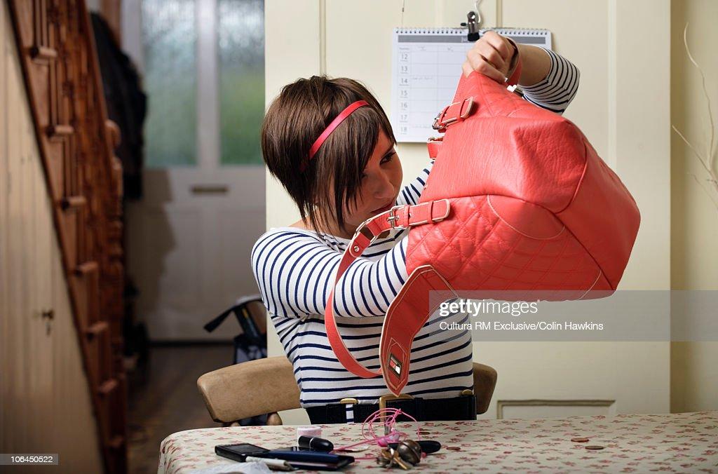 Woman looking in bag