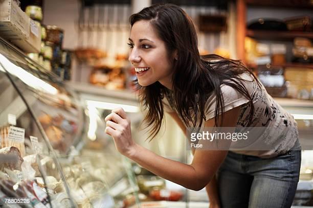 Woman Looking in Deli Display Case