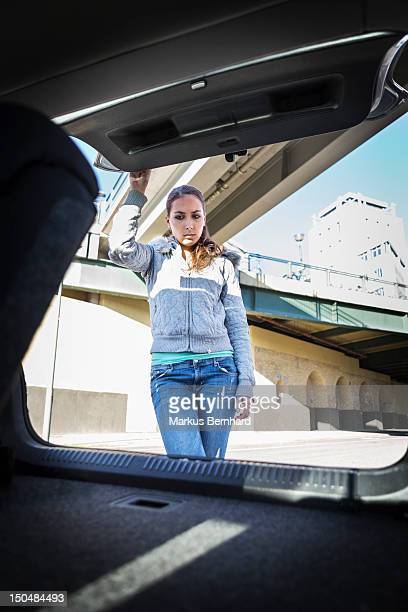 Woman looking into empty trunk
