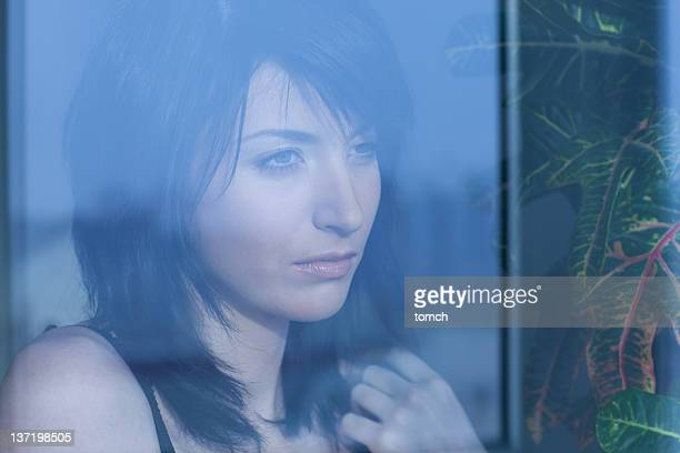 woman looking into window