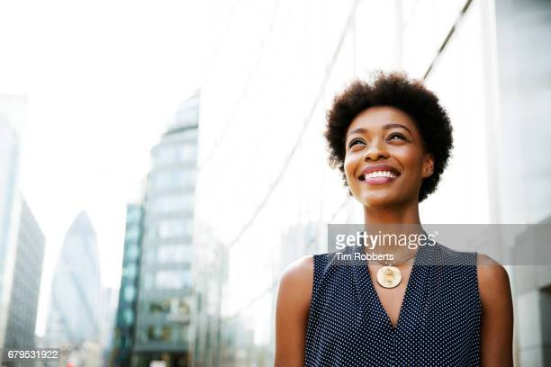 Woman looking next to buildings