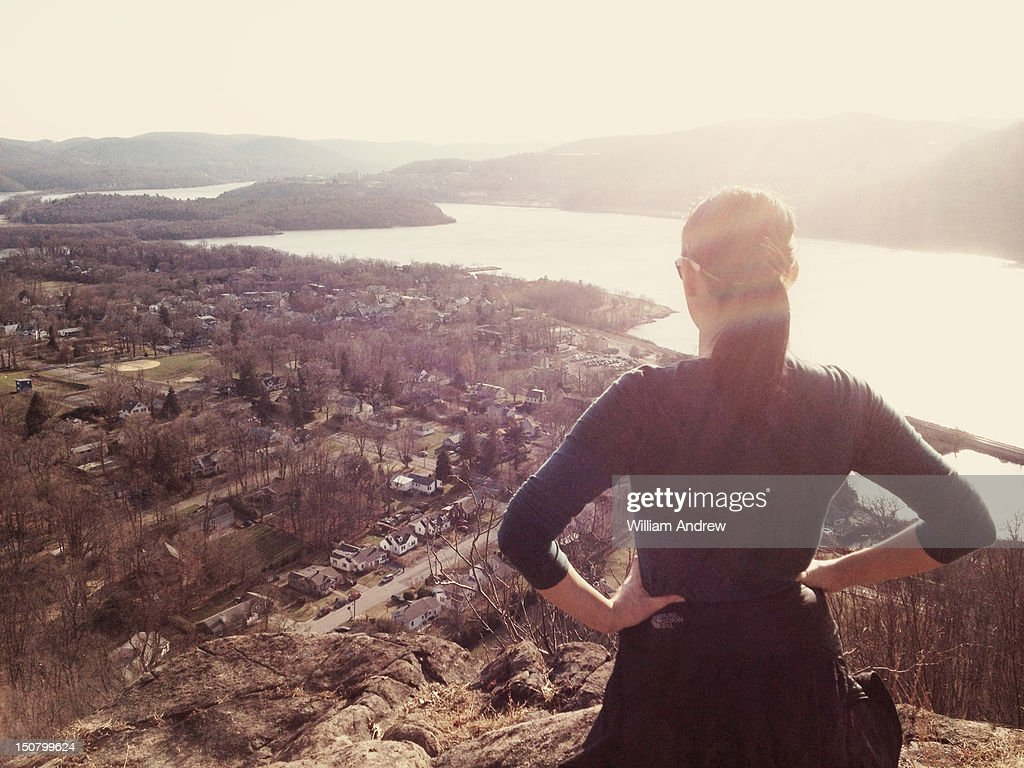 Woman looking out from mountain vista : Stock Photo