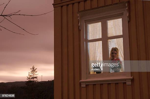 Woman looking out from window