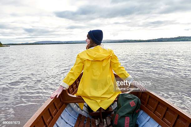 Woman looking out in a row boat