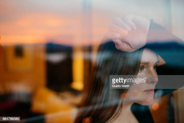 Woman looking out of a window.