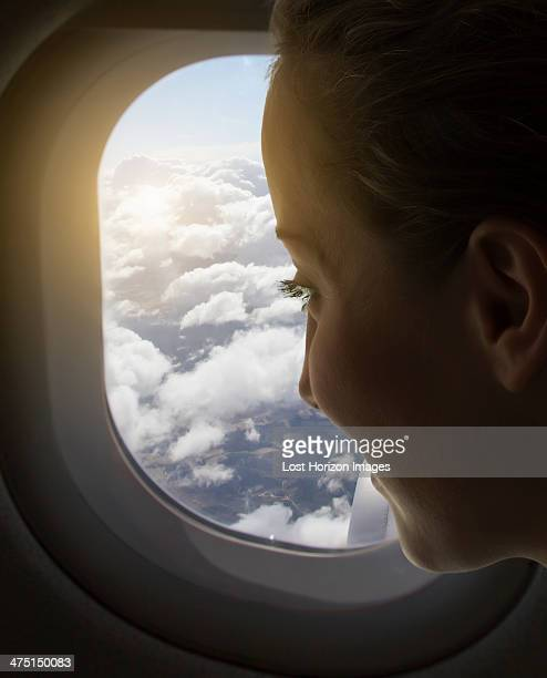 Woman looking out of airplane window