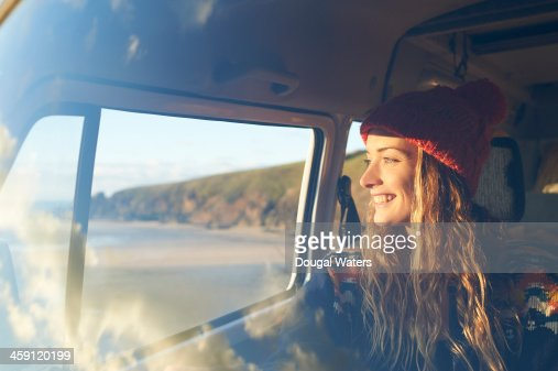 Woman looking out of camper van window. : Foto de stock