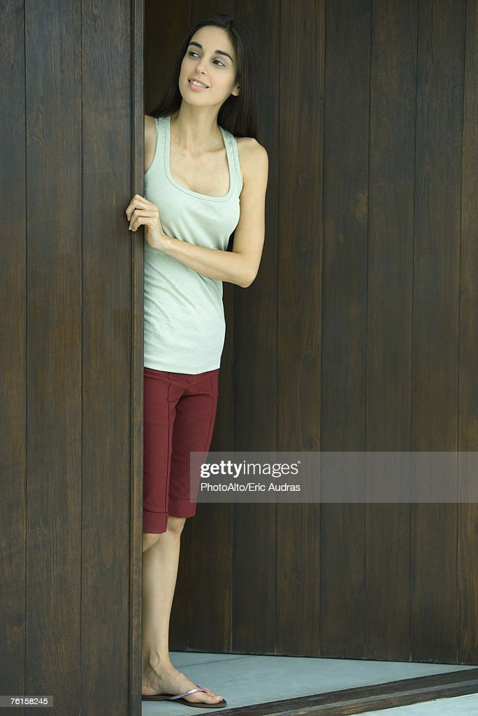 'Woman looking out of doorway, full length'