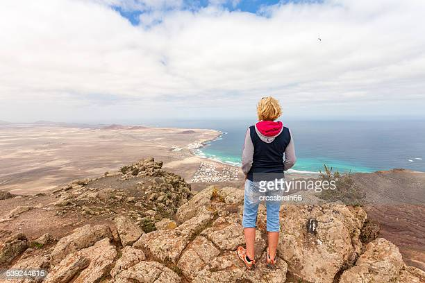 Woman looking out over the Atlantic ocean