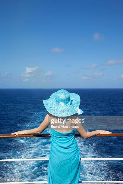 Woman looking out to sea on a cruise ship