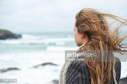 Woman looking out to sea. : Stock Photo