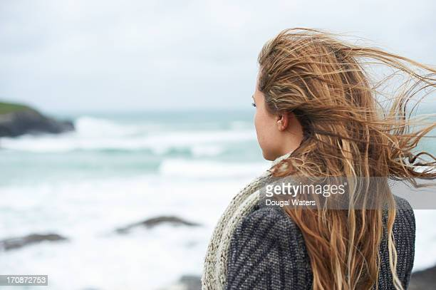 Woman looking out to sea.