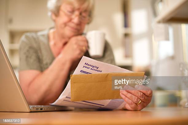 Woman Looking Over a Bank Statement