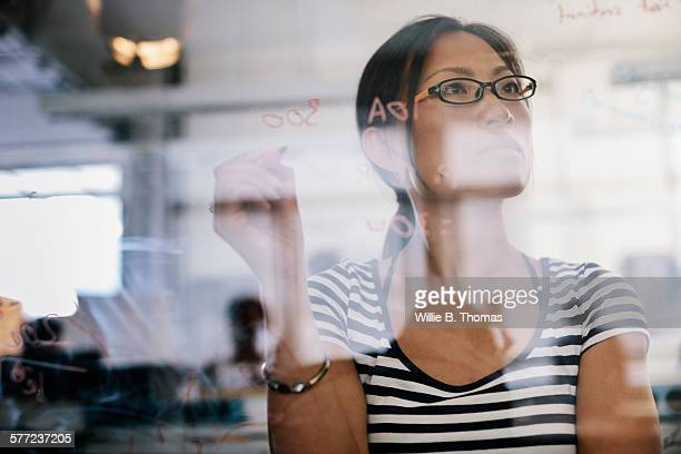 Woman looking over electronic schematic