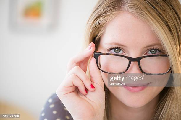 Woman looking over glasses