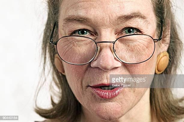 Woman looking over her eyeglasses