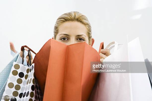 Woman looking over several shopping bags