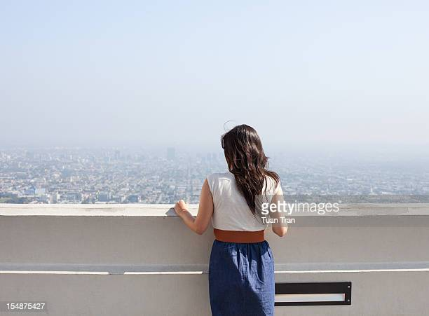 woman looking over the horizon