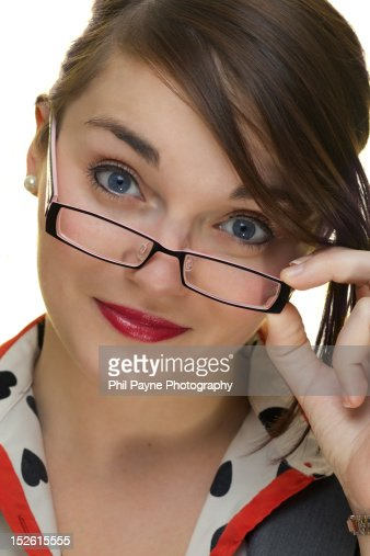 Woman looking over top of glasses : Stockfoto