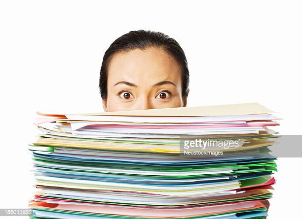 Woman Looking Over Work Files - Isolated
