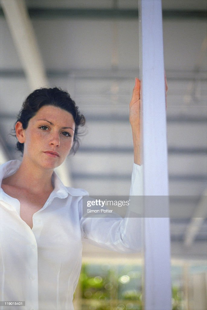 Woman looking through window : Stock Photo