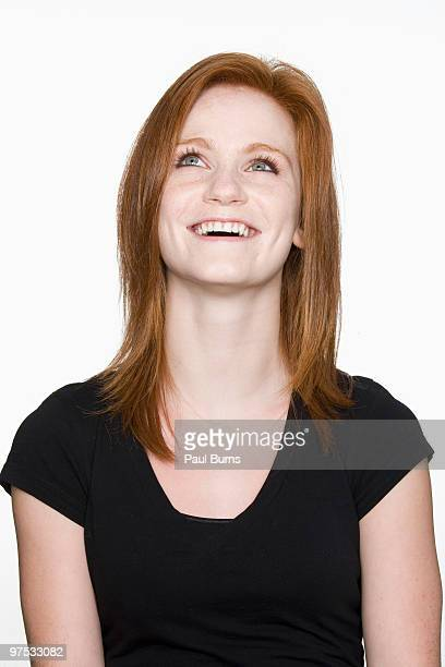Woman looking up and smiling