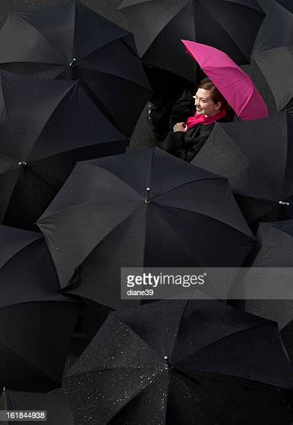 Woman looking up from under an umbrella