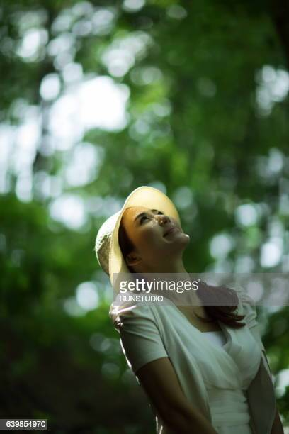 woman looking up in the park