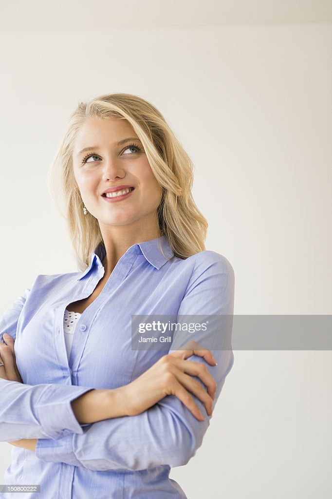 Woman looking up in thought : Stock Photo