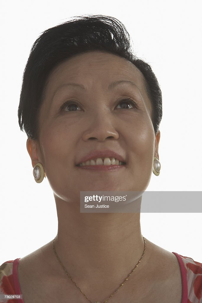 Woman looking up, portrait : Stock Photo