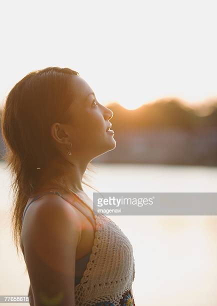 Woman looking up sky