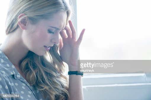 Woman looking upset or in pain.