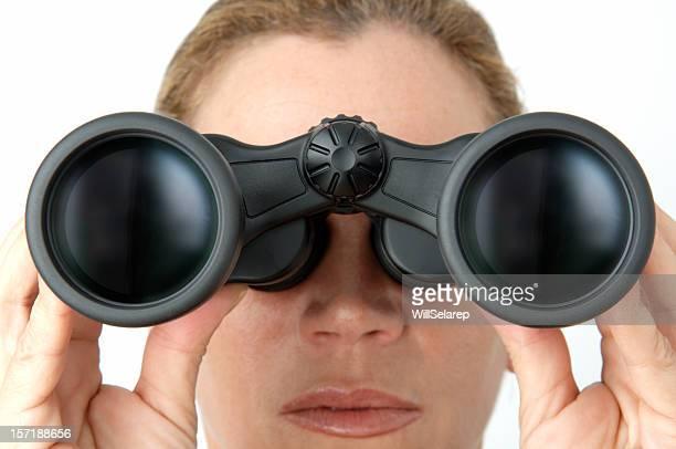 Woman looking with binoculars