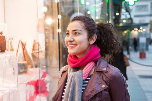 Woman lookinginto shopwindow, Champs Elysees.