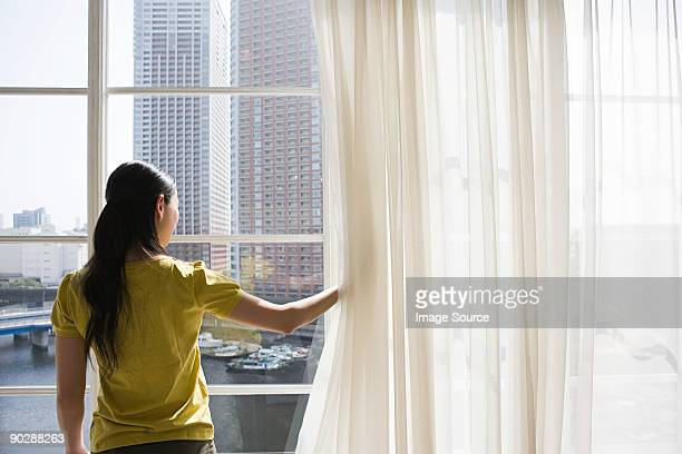 Woman lookinng through a window